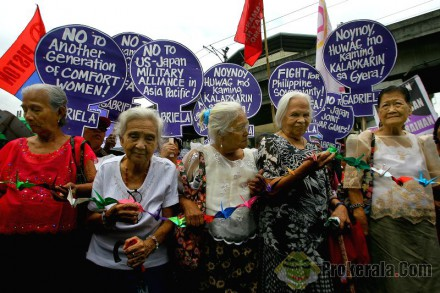 old-women-hold-origami-cranes-during-a-protest-379497